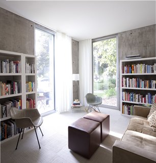 The study houses not only a pair of plastic Eames shell chairs but much of the couple's large collection of architecture and design books.