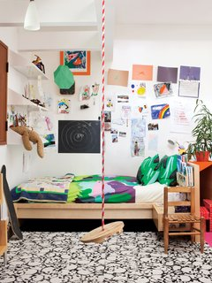 In addition to a swing, Cal's room features Maija & Kristina Isola's Sola bedding for Marimekko.