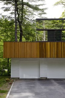 """""""The first floor was about making something warm and woody that would blend into the natural environment,"""" architect Stephen Chung says of his Wayland, Massachusetts, home. """"The second floor was a chance to experiment."""""""
