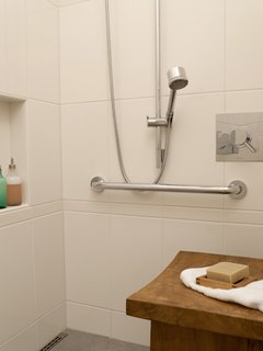 The shower can accommodate two, and has Hansgrohe heads of differing heights with separate controls from Cifial. The residents stayed away from a built-in bench and opted to switch out a variety of tables and benches as needed, to avoid dealing with the mold or water stains that quickly materialize in a built-in. Tile from Statements.