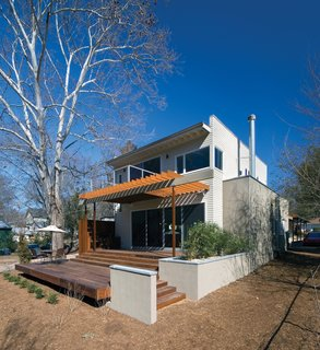 Instead of demolishing the existing house or adding a second story, the addition was added at the rear of the existing structure, separated by a new main entry courtyard. These new, public spaces take advantage of a connection to outdoor spaces at the rear of the lot.