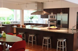 A screened porch and the kitchen were connected and are situated to enjoy southeast light and views of the site.