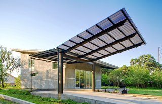 """After the home was completed, Wong asked for the carport addition. """"I handed Jay two books: one on Alexander Calder's mobiles, and one on insects,"""" says Wong. The result was a soaring, winglike steel, aluminum and Galvalume structure fabricated by the architects that gives additional protection from the sun, provides a smoother transition from exterior to interior, and allows clients and other visitors a covered space under which to park."""