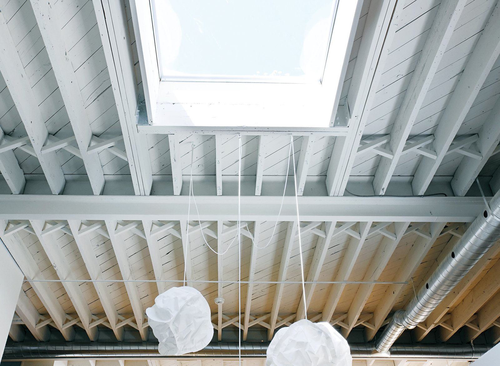 Skylights provide crucial natural light in the dining area and bedroom.  Photo 5 of 9 in An Art Studio That Would Make Picasso Jealous