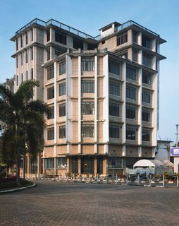 For a long time this building was the tallest building in Vientiane. I love the way it shoots straight up and out with those lines accentuating its verticality. That must have been quiet a terrace up on top in its heyday. It was probably built in the 1950s and housed the French Cultural Center back when the French were in control of the country. Apparently the members of the family who own it cannot come to any agreement and the building has been vacant for many years—except for one shop on the first floor.