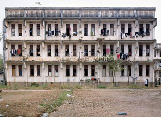 A view of the dorms at the National Polytechnic Institute in Vientiane. Built in 1984 with the help of Soviet engineers, these dorms accommodate students from around the country who come to study in Vientiane. Rooms have four to six bunk beds; bathrooms and washing areas are outside, at a distance from the buildings. I could tell which was the girl's dorm from the clothes hanging out to dry on the balconies.