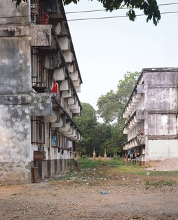 """Living in Laos - Photo 7 of 14 - These buildings and the Institute were built on land """"appropriated"""" by the government from Wat Sok Pa Luang (Forest Temple). This used to be a forest area outside Vientiane and is now very much part of the city."""