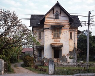 One of the things that struck me most when we first arrived in Vientiane was how so many of the old colonial houses were in such sad shape—it was like no one could care less. Slowly, I noticed that most were actually inhabited by families (Lao)—and often, more than one. Asking around, I learned that the predicament of these houses was very much in limbo; the government had taken possession of them in the years after the revolution (1975) as the owners began to flee. I was told if the former owners came back and showed proof of ownership there was a possibility of them getting their house back. I am sure few actually believe it. In the meantime, the tenants have no incentive to put their hard earned Kip (Lao currency) to fix something they don't own and could be taken away from them at any time.