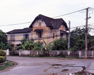 "These colonial houses are around the old center of town. They were originally residential houses built between 1914 and 1930 for the French colonial officials and administrators. The French brought Vietnamese masons and carpenters since they were already trained to build French style houses. Most of these laborers settled in Ban Anou, the old Vietnamese ""village"" in Vientiane."