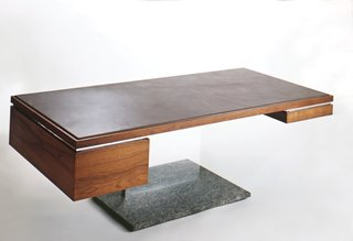 """A 500-pound executive status symbol? Yes, in the form of a $6,000 leather, wood, and bronze desk designed by Platner. """"I thought of these things as trees,"""" he said."""