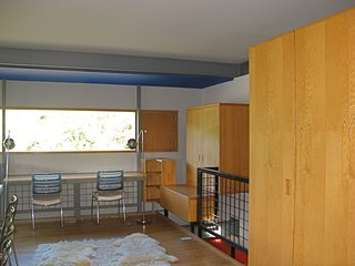 """A view of one of the boys' bedroom shows how the furniture was built into the wall and the relationship of walls to the floor, making clear, as Guyon has described, that this is really """"an experiment masquerading as a house."""" As is indicative of a pure Modernist home, all glass is fixed, with separate screened compartments for ventilation. Circulation and places of repose are also separated. As one can see at the right of the frame, the box is denied, the cube explodes, things come apart and nothing directly touches. """"Its not egalitarian, its completely elite. Though many find it to be bare bones, its just really intense in its craft,"""" says Guyon."""