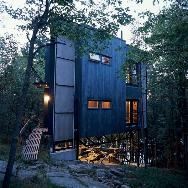 Playfully christened La Tour des Bébelles, the three-story, steel-framed tower has shown itself to be the ideal summer retreat: secluded, perfectly positioned near Ontario's Otter Lake, and encouraging of its inhabitants to spend time outdoors.