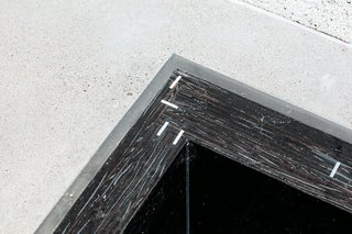 "A custom sink basin designed by Atherton Keener at a house in Arizona emphasizes the joint where two pieces of marine-grade plywood meet with aluminum spline joints. The sink was made by hand by dying the plywood and coating it in marine epoxy—an inexpensive, but by no means speedy—technique. The subtle, small-scale texture of the edge of the plywood contrasts in color and pattern with the dotted concrete countertops. <span style=""color: rgb(204, 204, 204); font-size: 13px;"">Photo by Ye Rin Mok</span>"