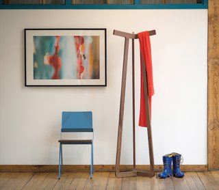 Here's their handsome Stretch coat rack, next to the metal-and-walnut Lockwood chair.