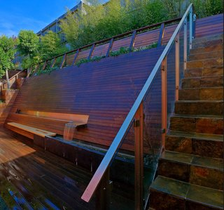 For a steeply sloping backyard in San Francisco, he devised this all-in-one wooden wall, which provides seating, a fountain that helps block out highway noise, and, at the top of the steps, a lookout point that offers a view on the surrounding neighborhood.