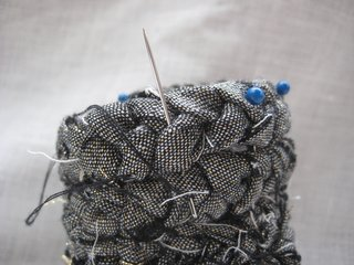 Braided Rag Vessels - Photo 10 of 14 - 7. Using a needle and thread, stitch between each row. Remove the pins when complete.