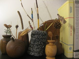 Braided Rag Vessels - Photo 12 of 14 - And here's my little mantle tableau. I put some twigs wrapped in embroidery floss in there for a bit of color, and surrounded it with some wooden bud vases that my grandpa made. Lookin' good! This project was seriously perfect for a drizzly afternoon indoors. The next one I make I'll try with a softer knit that might have less strays threads to trim away in the end, and it's tilting a little, so I will make sure that when I'm pinning it up it stays straight. Loads of fun, though, and I'd very highly recommend trying out your own textile vessels.