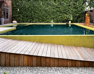 The final, layered look of the pool and its surroundings—which mitigates a 30-inch drop from house to guesthouse—was completed in 2008.