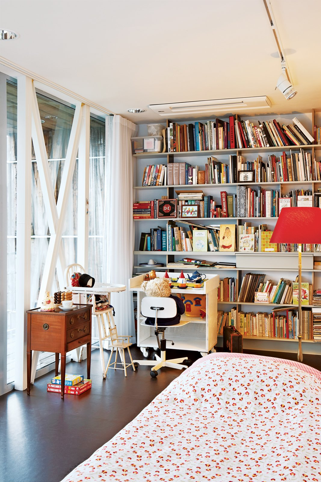 The cozy spare room filled with heirlooms is largely used by the couple's three young grandchildren.  Photo 8 of 14 in This Home Takes Recycling to the Next Level