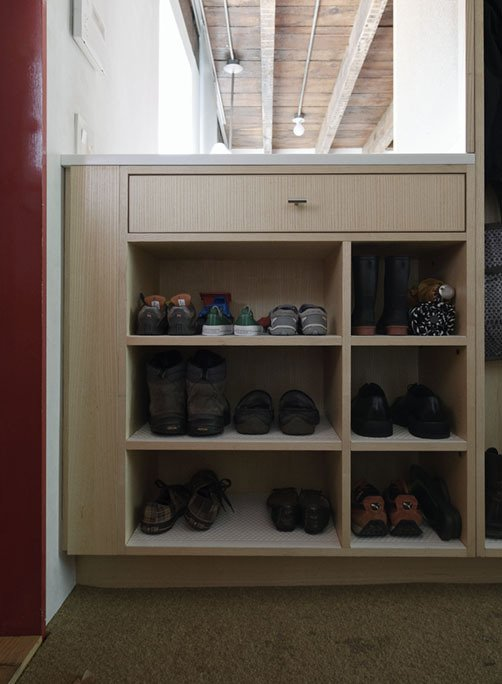 By the door, shoes get organized on a built-in by JKK Woodcraft.  Photo 15 of 28 in Family Home Renovation in Brooklyn