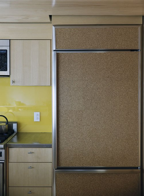 A fridge clad in cork provides a decidedly warm touch to the kitchen.  Photo 16 of 28 in Family Home Renovation in Brooklyn
