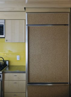 A fridge clad in cork provides a decidedly warm touch to the kitchen.