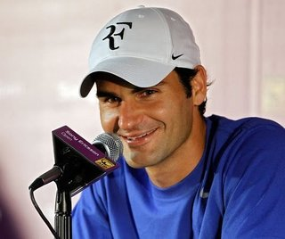 Roger Federer's Personal Logo? - Photo 1 of 3 - There's that logo on Fed's cap.