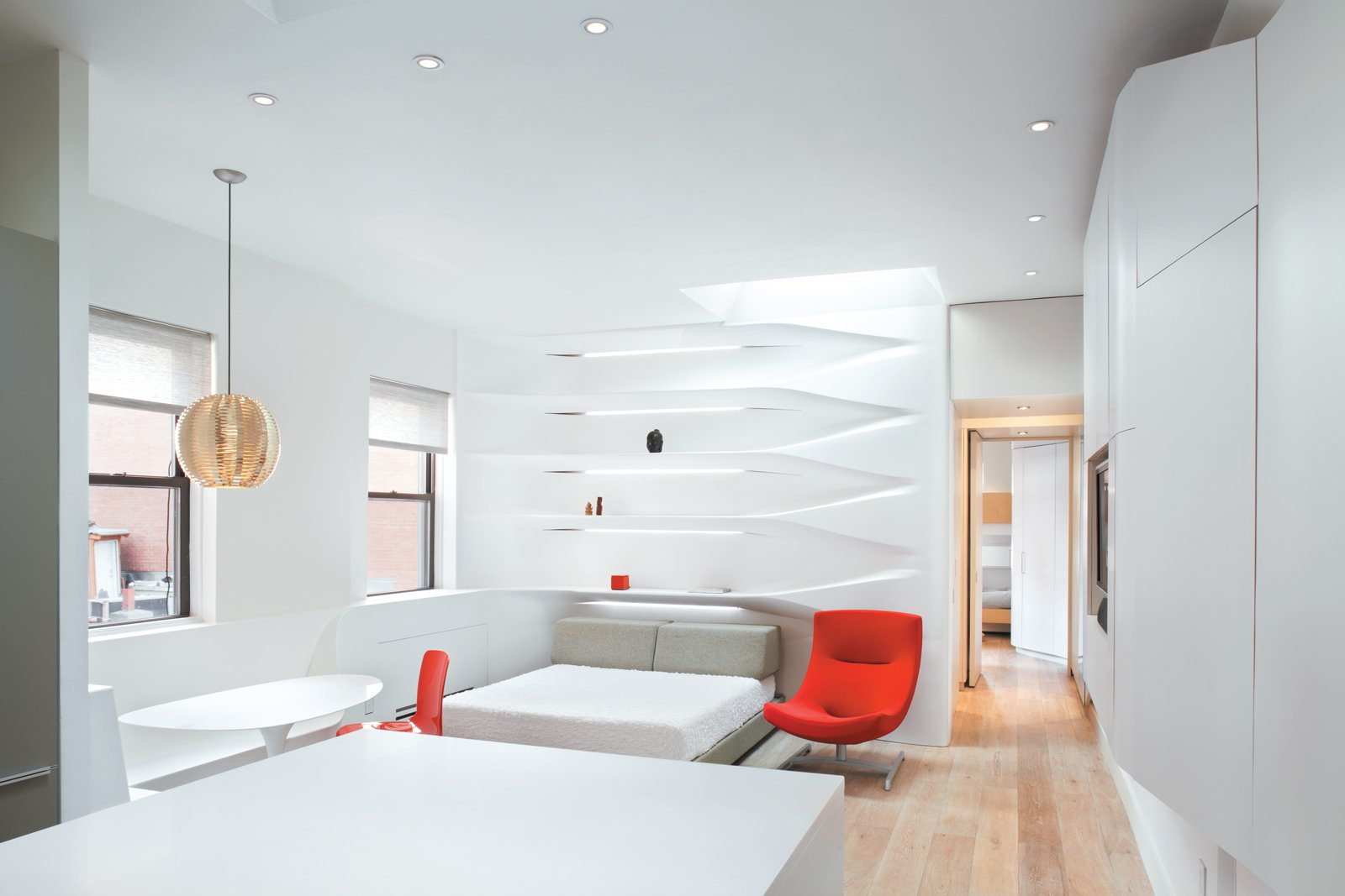 """In the apartment's new incarnation, the main living area is a family room that morphs—after the boys go to sleep in the back bedroom—into the parents' lair. As Krastev puts it, """"During the day it's a one-bedroom apartment, at night, a studio.""""  Photo 1 of 8 in All Together Now"""