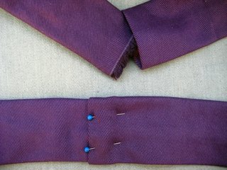 Fold one end of the strap under about 1/3 of an inch, then slip the other end in about the same amount. Pin the two together and sew along the seam.