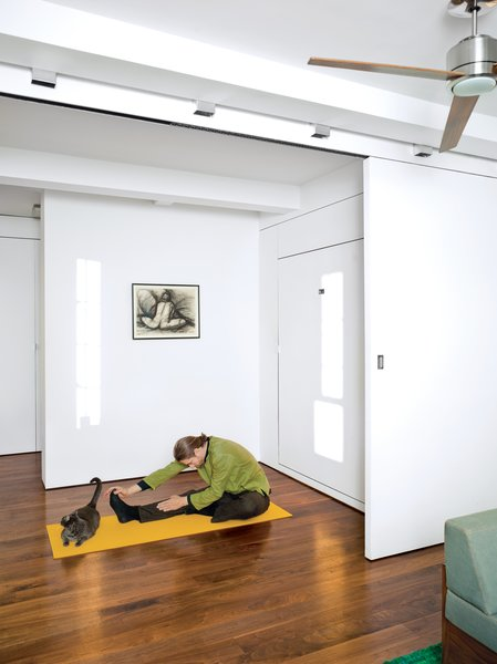 Once you fold up the Murphy bed in the bedroom, there's plenty of space for a stretch—even for Robert, who's six-foot-four.