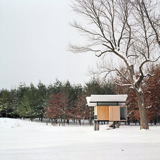 """In the winter, instead of floating over the pond, the hut sits lightly above the snow. """"It's protected and serene but alive with subtle energy,"""" Poss says. Photo by Phillip Kalantzis-Cope.Don't miss a word of Dwell! Download our  FREE app from iTunes, friend us on Facebook, or follow us on Twitter!"""