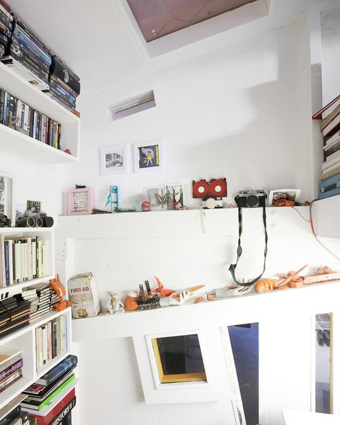 """Ionescu's room has built in shelving for his eclectic collections. """"We embrace everything—new, old, anything that embraces the truth in architecture,"""" says Ionescu. """"We've been compared to the Deconstructivists, but we like things that are decorative or made by hand—16th century objects, Art Nouveau, anything that has an aesthetic truth to it.""""  Photo 9 of 13 in Communal Living on a Budget in Brooklyn"""
