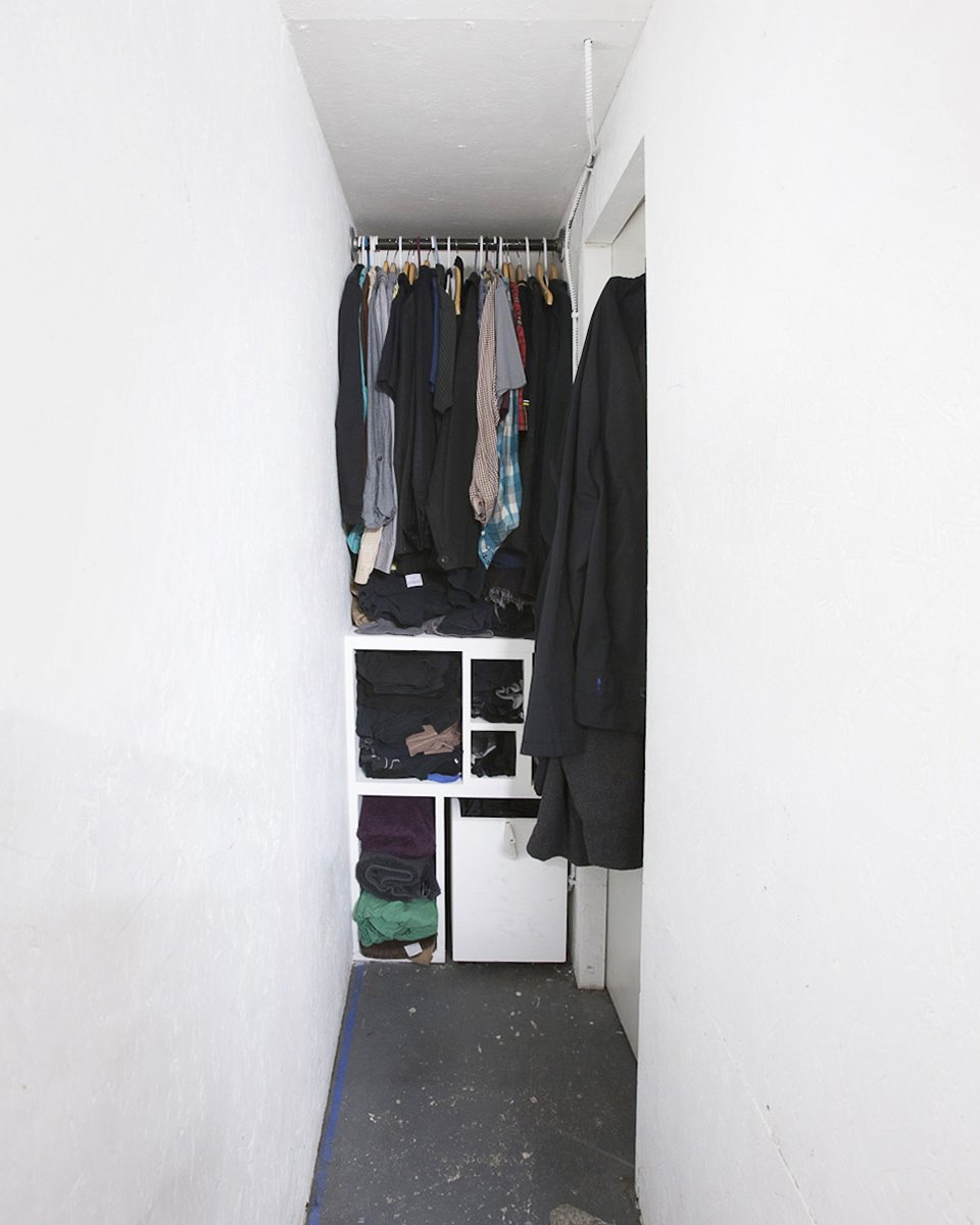 Every leftover space was put to use. Here, a narrow slot behind the structure allows just enough room for a tight walk-in closet.  Photo 10 of 13 in Communal Living on a Budget in Brooklyn