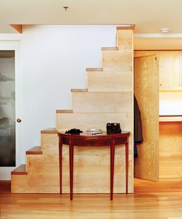 In a former shipping and receiving room, Kidd's design-builder Eric Wolf inserted a custom-crafted freestanding stair.