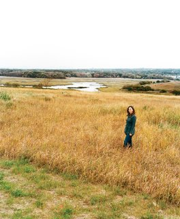 The tall vegetation surrounding Carrie Grassi, Freshkills Park land-use and outreach manager, grows atop what was formerly the world's largest landfill: 150 million tons of (mostly) garbage, accumulated over more than half a century.