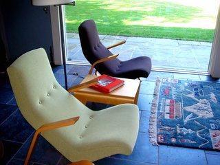 """These Saarinen Grasshopper chairs were recently reupholstered with Knoll fabrics. The bent plywood nesting table between the chairs was designed by Breuer in 1935, is currently produced by Isokon in London, and was the first furnishing purchased for the restoration. """"We used Ezra Stoller's period photography and the registrar's list from MoMA to see what was originally in the house,"""" says Cynthia Altman, Kykuit's Senior Curator. """"Luckily because mid-century has become so popular these days pieces are being reissued."""" Photo by Diana Budds."""