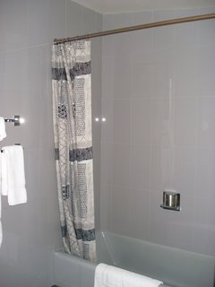 The new iteration of the bathroom features Carrara glass tile, though the original was plywood. Photo courtesy of the Rockefeller Brothers Fund.