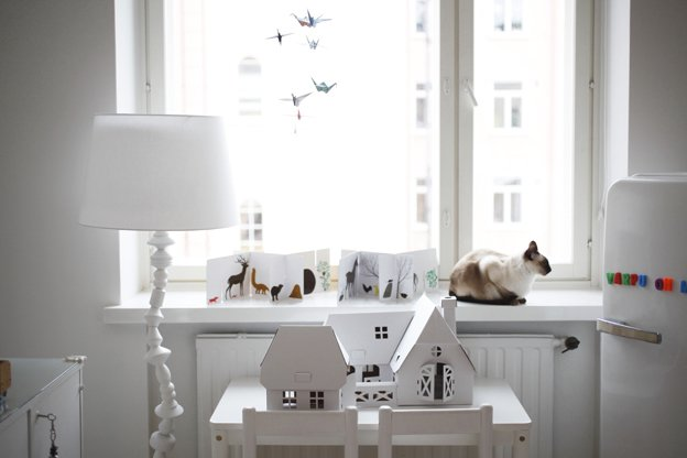 The flags and other bright accents bring a shot of color and fun to the serene, white-filled bedroom.  Photo 15 of 16 in Fine Finnish
