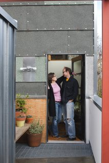 "The exterior is a mix of asphalt roll roofing, SnapLock metal panels, and Hardipanel. ""The cladding was something I had fantasized about for a long time,"" Hale says. ""Most clients wouldn't be psyched about it—who knows if I'll be psyched about it in five years."" But for now, the house is home to a very happy family."