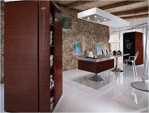 In addition to the island and wall section, the system also features standalone cabinets which can house pots, pans, and dishes as well as appliances.