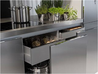 This detail of the Duality Kitchen shows the built-in storage, rendering additional kitchen furniture and shelves unnecessary.