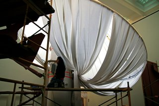 "Brooklyn Museum's reOrder - Photo 5 of 12 - ""It's kind of a high-tech fabric,"" Lukyanov says of the material that ultimately establishes the columns' exaggerated silhouette. The durable acrylic-based fabric, donated by Sunbrella, is stain, UV, mold and moisture resistant."