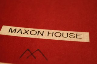 """Notebook cover of one of our inspiration books. Here is where we really started to give the house its own identity, and the """"Maxon House"""" name was born. Using the """"M"""" from my branding company's logo, we started to concept out a treatment of 'Maxon House' for signage."""