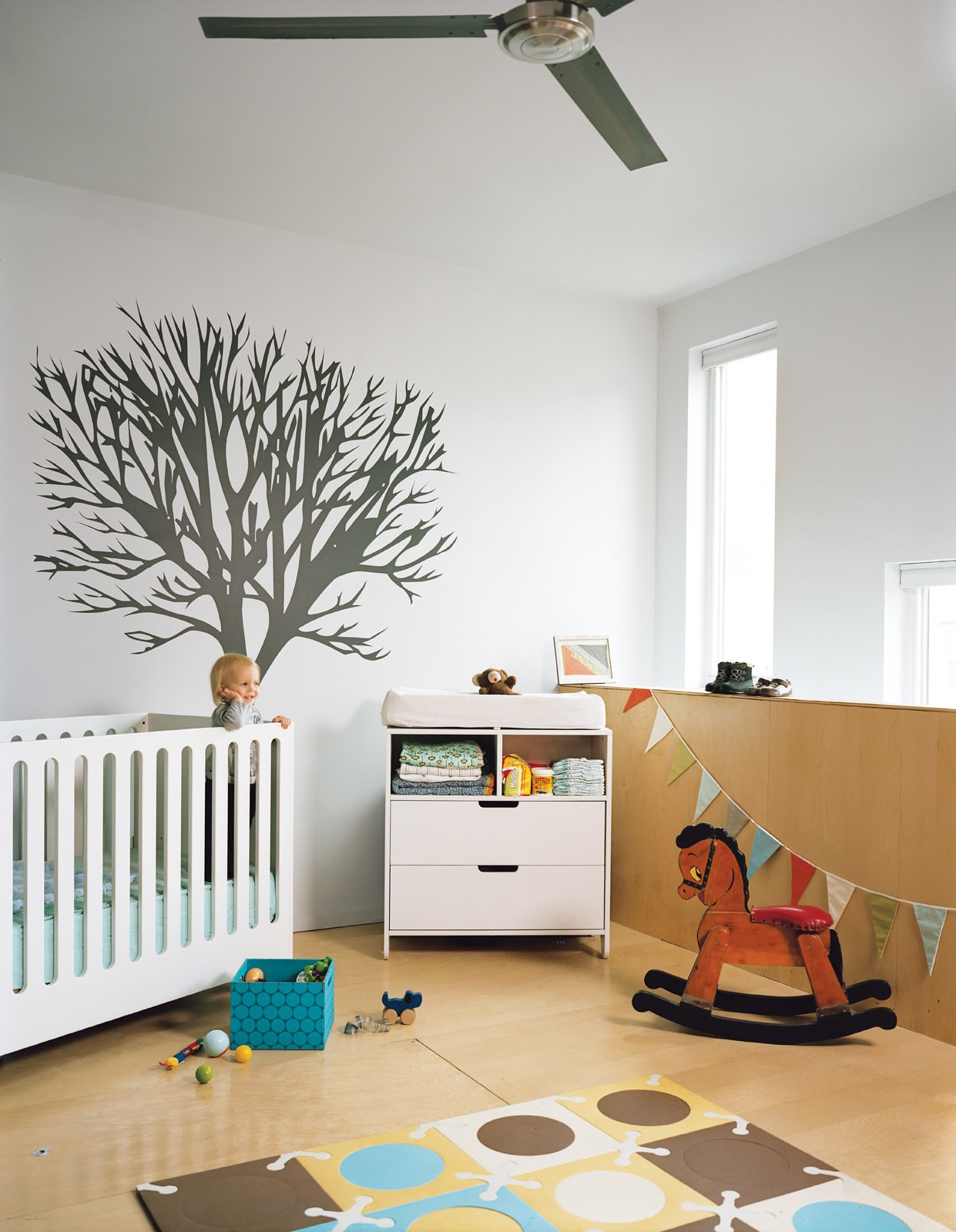 Teague plays in his Hiya crib from Spot on Square.  Photo 10 of 20 in 20 Cool Cribs for the Modern Baby from Green Urban Housing in Philadelphia