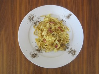 Pasta Carbonara - Photo 2 of 4 - Anne's homemade pasta carbonara, plated with her requisite generous serving of black pepper.