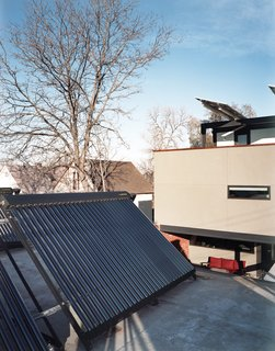 "An array of solar thermal tubes crowns the garage, and photovoltaic panels extend like wings over the third-floor deck. ""If we were going to make a big architectural move, we had to have reasons,"" Moore explains, referring to the conspicuous placement of the panels."