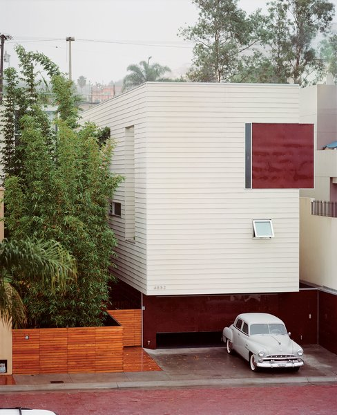 The Becerril family embraces stark modernism with a mute facade clad in Hardie board and acrylic panels. Access to the heart of the house is through the bamboo garden.  Photo 5 of 13 in Modern in Tijuana