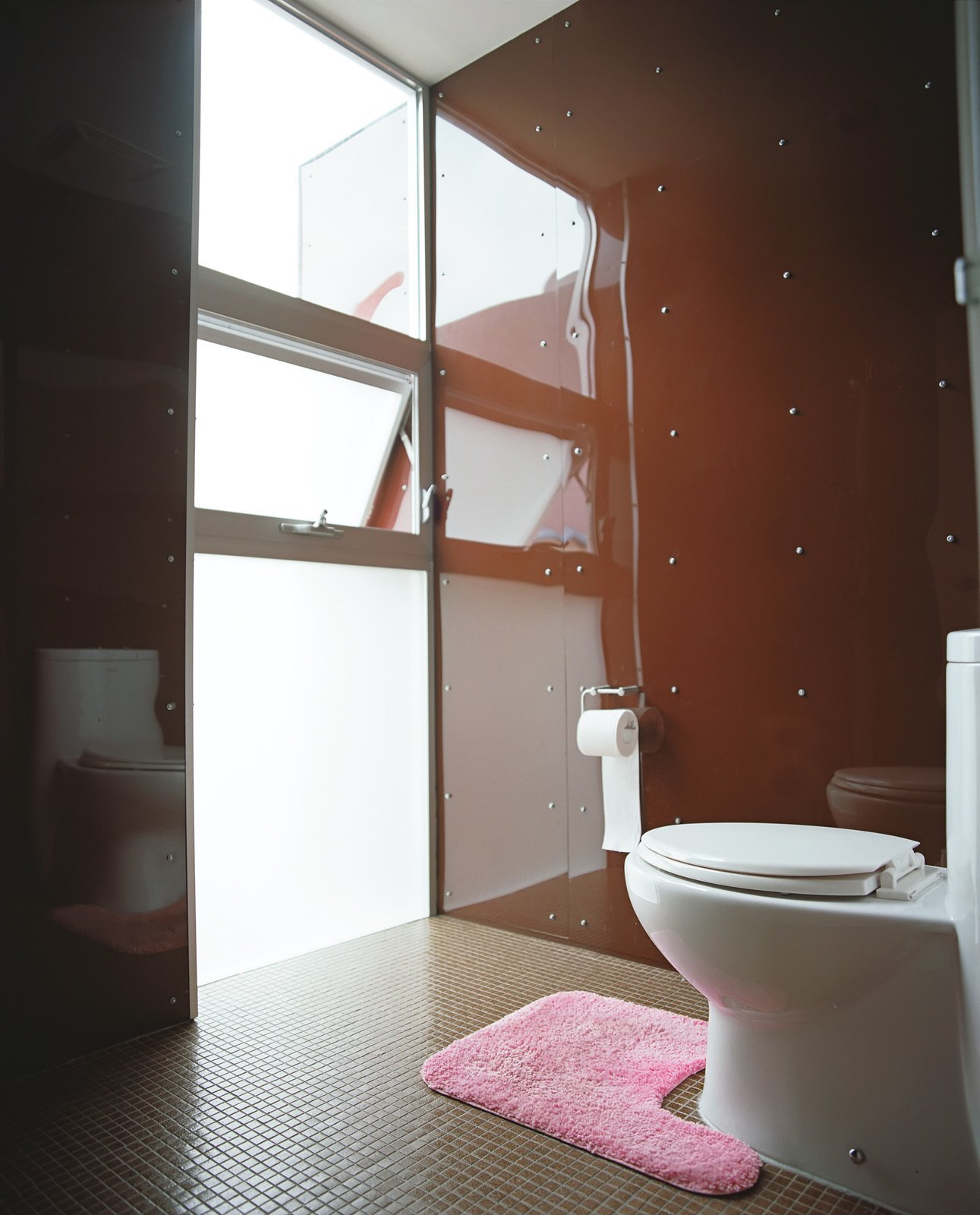 Bath Room Despite a tight site, light floods into every room, including the restroom in the guesthouse.  Photo 12 of 13 in Modern in Tijuana
