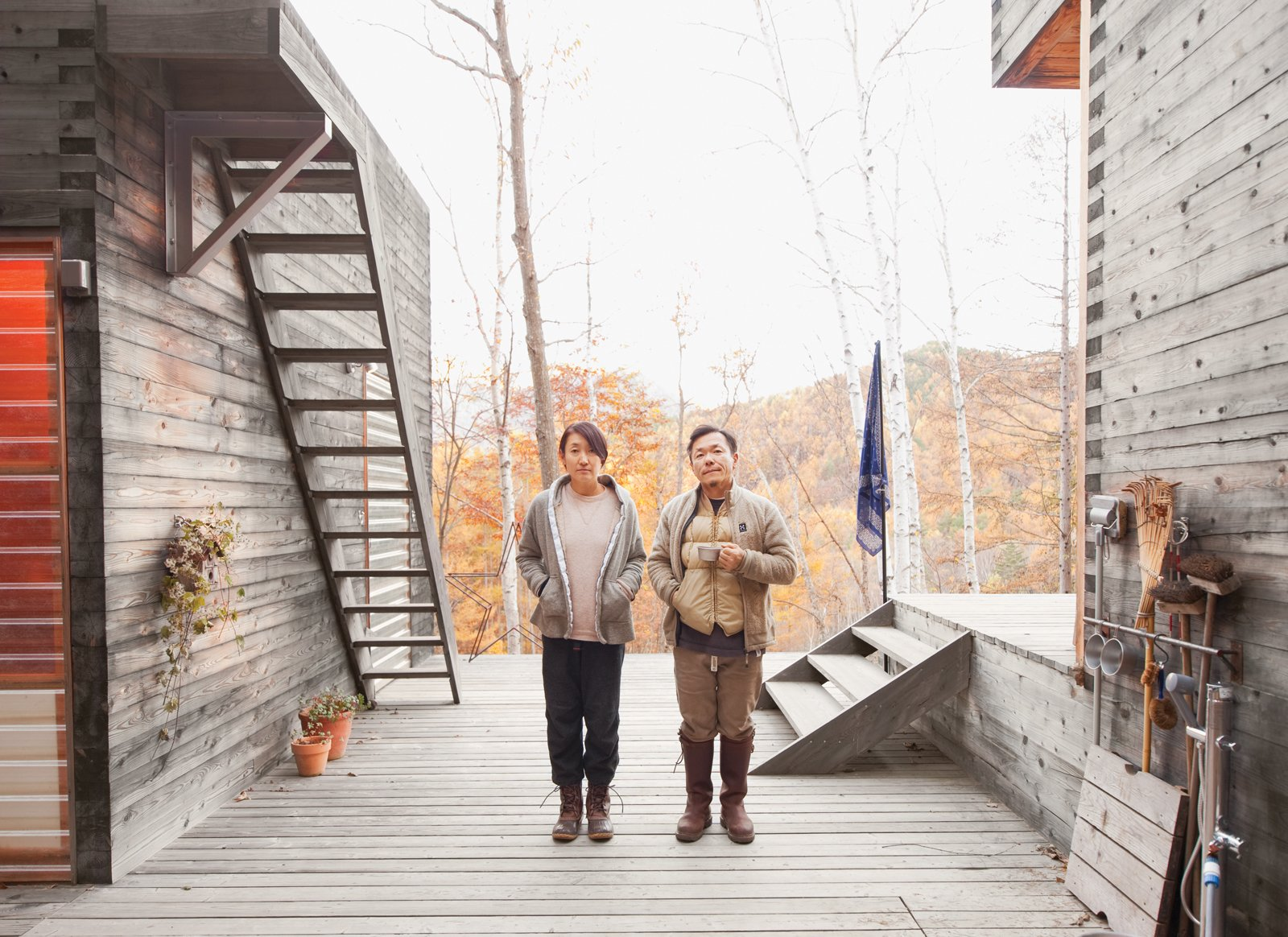 Outdoor, Wood Patio, Porch, Deck, and Large Patio, Porch, Deck Setsumasa and Mami Kobayashi are ready for adventure.  Photo 7 of 28 in A Platform for Living