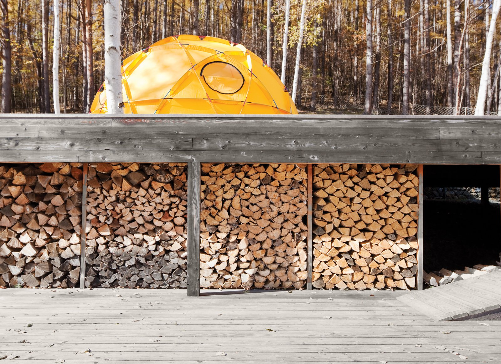 Outdoor, Large Patio, Porch, Deck, and Wood Patio, Porch, Deck A stockpile of wood sheltered from the elements.  Photo 15 of 28 in A Platform for Living